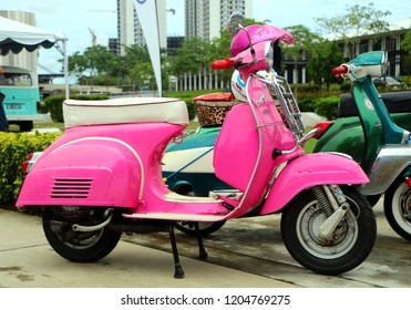 Setia Alam, Selangor, Malaysia - October 14, 2018 : Elegantly designed of Pink Vespa scooter parked in a street at Setia Alam, Selangor. Vespa is an Italian brand of scooter manufactured by Piaggio.
