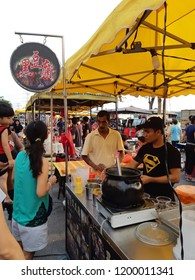 Setia Alam, Selangor/ Malaysia - September 29 2018: Visiting the famous Black Taufu stall at the biggest night market in Malaysia. People are queuing even before night falls.