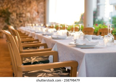 Setout table with tableware in modern restaurant.