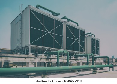 Sets of cooling towers in data center building.