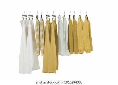 Sets of elegant and trendy men's clothes hanging in a shop for sale.