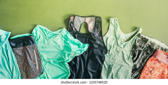 Sets of the fitness sport clothes are on the training joga mat