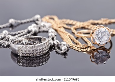 sets of gold and silver : ring and an elegant chain