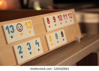 Sets of rummy pieces on a board