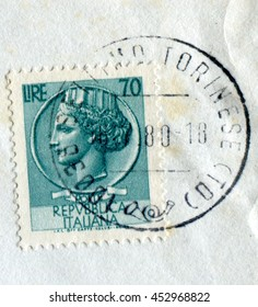 SETTIMO TORINESE, ITALY - CIRCA JULY 2016: A stamp printed by Italy shows the Repubblica Italiana (meaning Italian Republic) represented as a woman