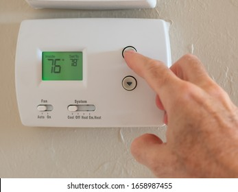 Setting digital thermostat to cool and programming air conditioning to energy saving temperature of 78 degrees.