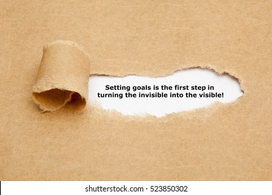 Setting goals is the first step in turning the invisible into the visible! Inspirational quote typed on typewriter.