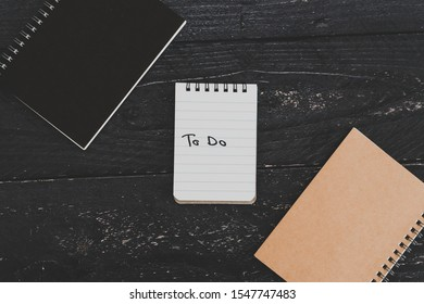 setting up for success conceptual still-life, business desk with variety of notebooks with To Do text on it
