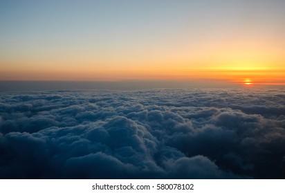 Setting Sun Above Clouds