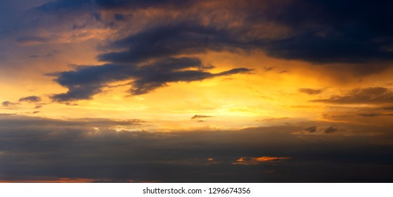 The setting sun breaks through the dark clouds.sunset sky panorama.
