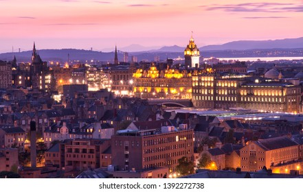 Setting Sun illuminates Edinburg  Scotland