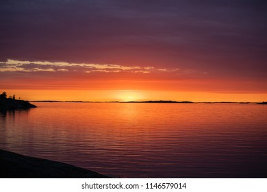 The setting sun on the Island of Aspö in Archipelago National Park (Skärgårdshavet nationalpark), Finland, 4 days after the summer solstice.