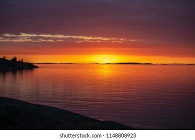 The setting sun on the Island of Aspö in Archipelago National Park (Skärgårdshavet nationalpark), Finland, 4 days after the summer solstice.