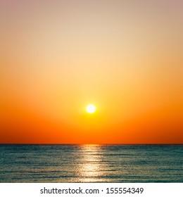 Setting sun on pacific ocean. Beautiful sunset, sunrise sea horizon