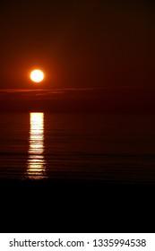 Setting sun over a coastal beach