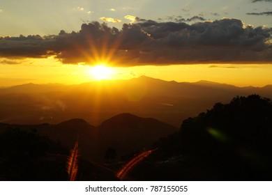 setting sun over mountains
