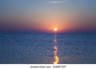 Setting sun over sea / Setting sun over blue sea in summer