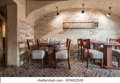 Setting table for four people in restaurant