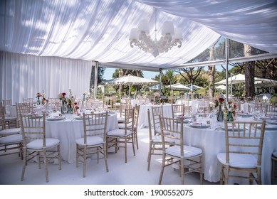 Setting up for the ultimate wedding  venue in a marquee, all in white in Naples Italy