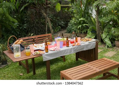 settle wooden table outdoor and red plate with beers for food and barbecue after camping party