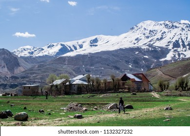 A settlement nestled at the base of snow capped mountains, Drass, Kargil, J&K.