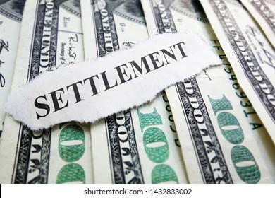 Settlement newspaper headline on money