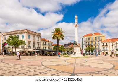 Setubal, Portugal - August 28, 2020: View of the Bocage square in Setubal, Portugal, with emphasis on the statue of the poet Bocage and around old buildings with terraces, on a summer day.