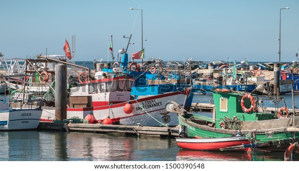Setubal, Portugal - August 8, 2018: View of Setubal fishing port and its fishing boats on a summer day