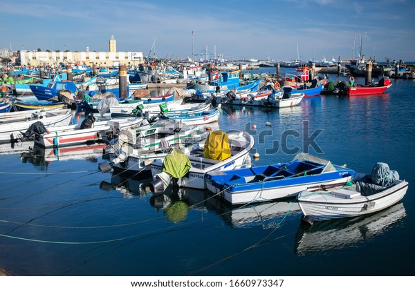 SETUBAL, PORTUGAL - February 22, 2020 : Setubal fishing port and its fishing boats in winter day
