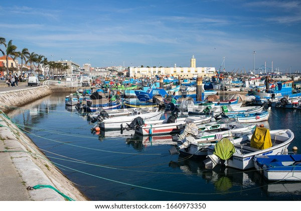 SETUBAL, PORTUGAL - February 22, 2020 : Setubal fishing port and its fishing boats in winter day