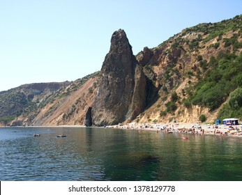 Sevastopol, Crimea - July 15, 2008: The peninsula of Crimea and Black sea. Jasper and wild beach on the Black sea shore in the area of Fiolent. Rocks and cliffs of the southern coast of Crimea