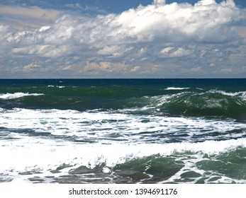 Sevastopol, Crimea - July 17, 2008: The peninsula of Crimea and Black sea. Emerald and pearl color of Black sea waves. The wild coast on the raging Black sea in the area of Chersonesos cape