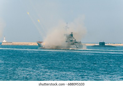 Sevastopol, the Crimea. Large warships are firing from guns on the parade of the day of the navy in Russia.