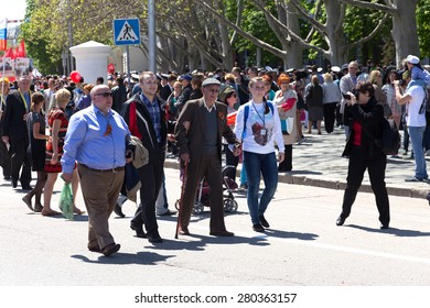 SEVASTOPOL / CRIMEA - MAY 9, 2015: People are columns in the Parade in honor of the 70th anniversary of Victory Day, May 9, 2015 in Sevastopol