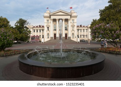 Sevastopol, Crimea, Russia - July 24, 2019: Seaside Boulevard with a fountain at the Sevastopol Palace of Children and Youth Creativity in the early summer morning, Crimea