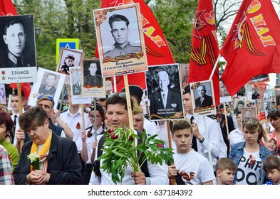 "Sevastopol, Crimea, Russia, May, 09, 2017. People with portraits of relatives - participants of the great Patriotic war of 1941-1945, during the action ""Immortal regiment"" on the Nakhimov Avenue"