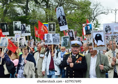 """Sevastopol, Crimea, Russia, May, 09, 2017. People with portraits of relatives - participants of the great Patriotic war of 1941-1945, action """"Immortal regiment"""" on Nakhimov Avenue in Sevastopol"""