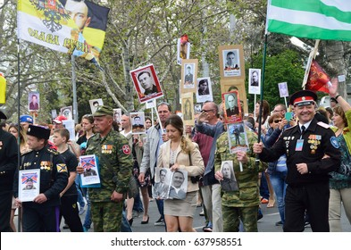 "Sevastopol, Crimea, Russia, May, 09, 2017. People with portraits of relatives - participants of the great Patriotic war of 1941-1945, action ""Immortal regiment"" on Nakhimov Avenue in Sevastopol"