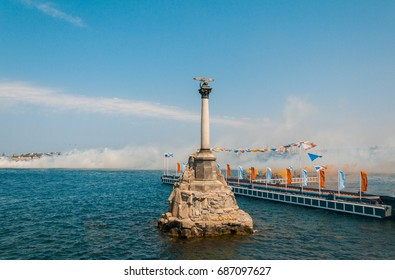 Sevastopol, Crimea, Russia. Report from the Russian Navy parade in the city of Sevastopol. In the foreground is a monument to the Flooded Ships, in the background military ships and equipment.