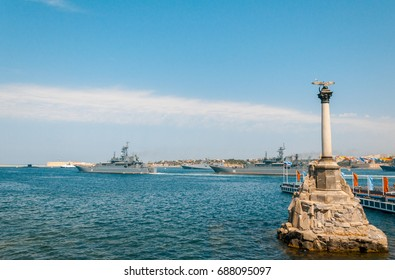 Sevastopol, Crimea, Russia. Report from the Russian Navy parade in the city of Sevastopol. In the foreground is a monument to the Flooded Ships, in the background military ships and equipment