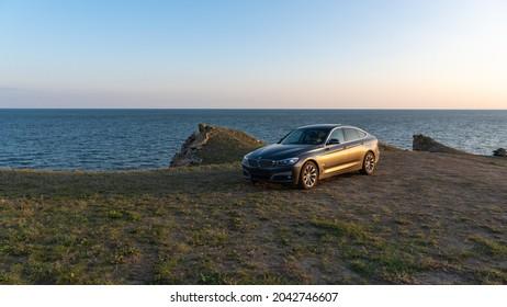 Sevastopol, Crimean peninsula, Russia - September 5 2021: BMW 3 Series Gran Turismo, against the backdrop of rocks and sea.
