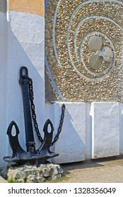Sevastopol, Russia - 29 Aug 2016: Anchor & submarine propeller at entrance to Balaklava Ship Repair Yard 'Metallist', famous plant repairing diesel submarines during Second World War