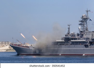 """SEVASTOPOL, RUSSIA - JULY 26, 2015: The Large Landing Ship """"Azov"""" of the Russian Navy makes missiles launch during Marine Parade on the Navy day in Sevastopol bay, Crimea Republic"""
