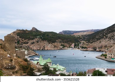 Sevastopol, Russia - September 22, 2014: Top view of western part of Balaclava bay,  rock peaks of Mytilino and Kaia-Bash, towers of  fortress Cembalo on mountain Kastron