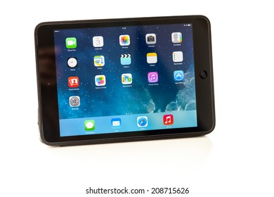 Sevastopol, Russian Federation - August 3, 2014: Apple iPad mini is a tablet produced by Apple Inc. displaying iOS 7.1 homescreen. iOS 7.1 operating system designed by Apple Inc. output 10 March 2014.
