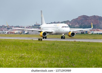 Seve Ballesteros airport, Santander, Spain - 9 August, 2018: Vueling Airbus 320 on the landing strip. Vueling offers flights from Santander to different European cities such as Copenhague, Paris...