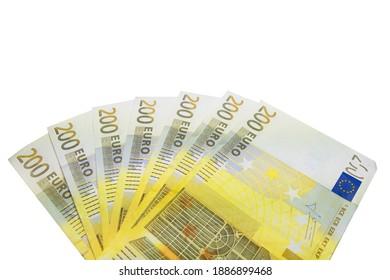 Seven 200 Euro bills arranged in a fan from above