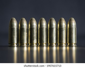 Seven 9mm luger bullets in a row