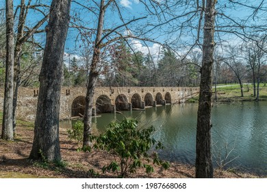 Seven arched bridge crossing over Byrd lake in the state park on a angle view in springtime on a sunny day