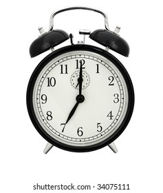 Seven of clock. Old alar clock on white background